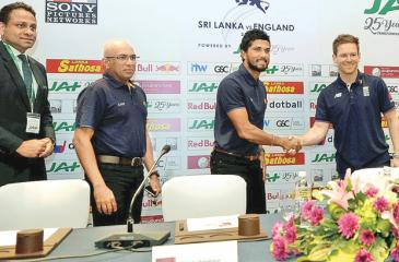 Sri Lankan captain Dinesh Chandimal and his England counterpart Eoin Morgan shake hands at the launch of the series   (Picture by Herbert Perera)