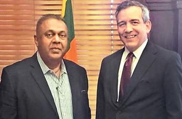 Executive Vice President of the Overseas Private Investment Corporation, David Bohigian meets Minister of Finance and Mass Media, Mangala Samaraweera.