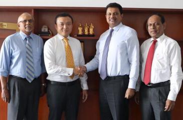 Standing left to right: COO of Hambantota International Port Group,Tissa Wickramasinghe, CEO of Hambantota International Port Group, Ray Ren, Group Chairman of Laugfs Holdings,W. K. H. Wegapitiya, and Executive Director, Laugfs Holdings Mr. H A Ariyarathna.