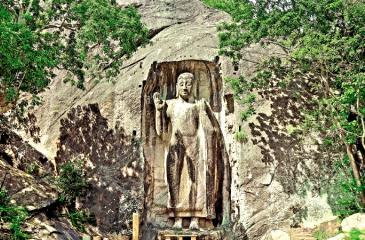 ELOQUENCE IN STONE: The magnificent Sasseruwa Buddha carved out of a single rock rises to a height of over 42 ft.
