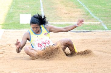 A.U.K. Sulawansa who cleared a distance of 6.04m to win the women's long jump in action  Pic: Ranjith Asanka