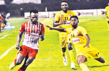 Super Sun's Mohamed Fahim (right) and New Youngs player BS Nimo vie for the ball in their Dialog Champions League football match at the Durayappa Stadium in Jaffna
