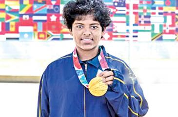 Hasini shows her gold medal