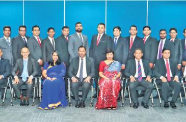 AIA's certified trainers with AIA Deputy CEO and Chief Agency Officer Upul Wijesinghe, members of AIA's Executive Committee, HR team, Training team and City & Guilds Quality assurance officer Anton Thevathasan and Managing Director, DAASH Global, Harshana Dassanayake.