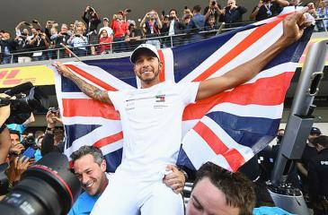 Hamilton drapes himself in a Union Jack flag