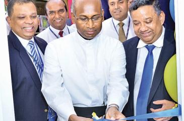 Rector St. Sebastian's College, Rev Fr Ranjith Andradi, Managing Director/CEO of HNB Jonathan Alles and , Board Director, HNB open the new Student Savings Unit.