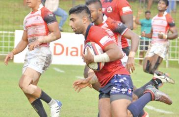 CR's play-maker Tharinda Ratwatte makes a break to cross the line and score Pic: Thilak Perera
