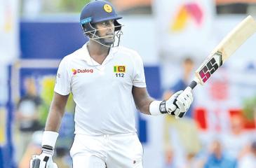 Sri Lanka's Angelo Mathews celebrates his half century (AP Photo by Eranga Jayawardena)