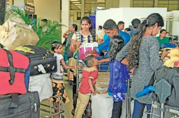 Refugees returning home to Sri Lanka  from India await clearance at the Bandaranaike International Airport.