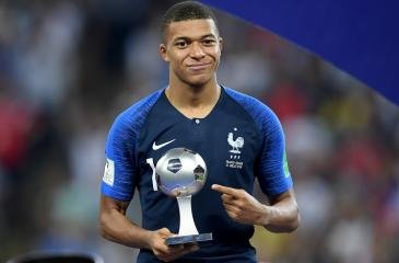 Kylian Mbappe of France with his Best Young Player Award  (Photo by Matthias Hangst/Getty Images)