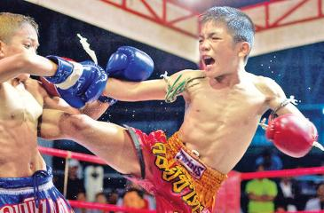 Two Thai children fight at a kick-boxing match Courtesy Getty Images