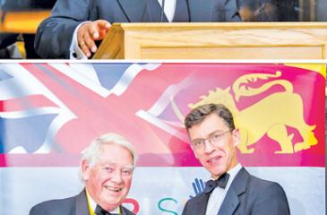 BRISLA Awards 2018 at Lord's Cricket Ground. (Top): Altair Director Pradeep Moraes addressing the event and (below) Lord Naseby (left) receiving the award from British High Commissioner to Sri Lanka, James Dauris.