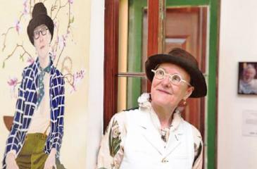 Lynn Savery with her Doug Moran prize-winning self-portrait.   Pic: Carly Earl for the Guardian