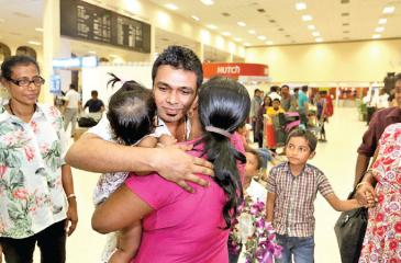 Lahiru Madushanka is being greeted by his family on arrival at the BIA
