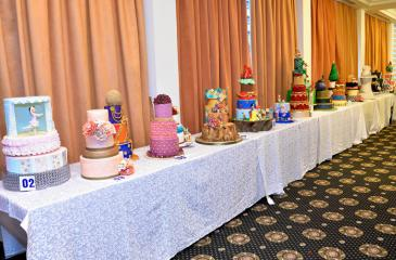 The cakes made by the students on display at the graduation ceremony.
