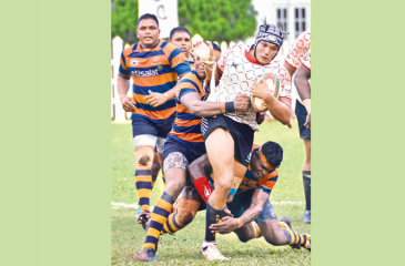 CH and FC player Rohitha Rajapaksa is held back by the Army defence Picture by Saman Mendis