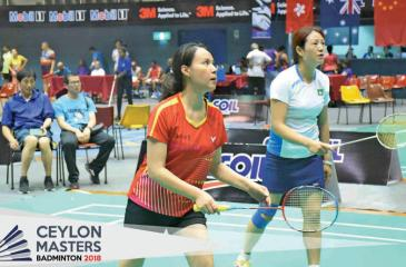 Two Chinese women confronting two Indian women  in the 45+ doubles match
