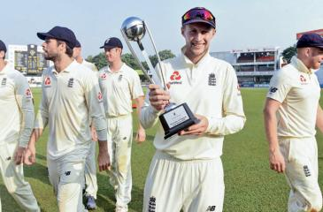 Joe Root leads his triumphant England team out of the SSC ground in Colombo (AFP)