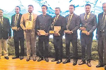 The Talawakelle Tea Estate team at the Presidential Environmental Awards 2018. From left: Senaka Alawattegama, Sarath Ranaweera, Aruna Dissanayake, M. M. K. Bandara, Rakitha Pathiraja, Nalin Kumara, Eranga Egodawela and Dilantha Seneviratne.
