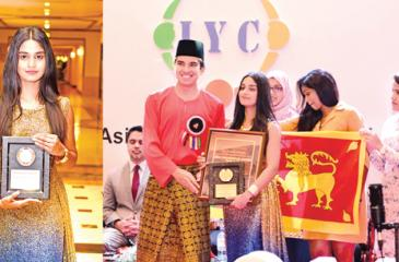 Popular teledrama actress Michelle Dilhara receiving the Asia Inspiration Award 2018, from Syed Saddiq Syed Abdul Rahman, Minister of Youth  and  Sports, Government of Malaysia.