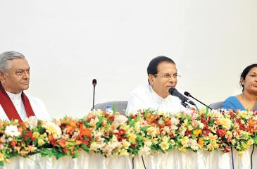 President Maithripala Sirisena addresses Health Ministry officials   while  parliamentarian Chamal Rajapaksa and Health Ministry SecretaryWasantha Perera look on.