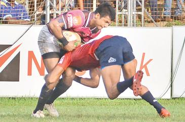 Havelocks centre Chamara Dabare is tackled by a CR defender  Pic by Thilak Perera
