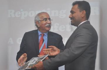 Dr. Achala Jayatilleke handing over the translation to Dr. Patanjali Dev Nayar