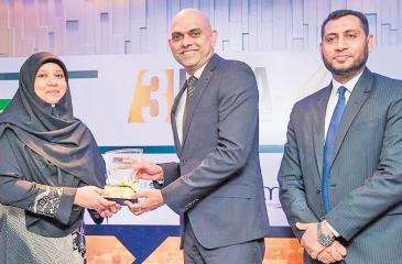 Commercial Leasing & Finance PLC's Director/ CEO Mr. Krishan Thilakaratne receives the award for the Islamic Finance Entity of the Year