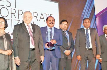 SLT Group Chairman P. G. Kumarasinghe Sirisena with the award
