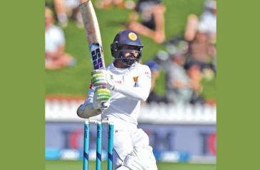 Sri Lanka's Niroshan Dickwella plays a shot during day one of the first Test cricket match between New Zealand and Sri Lanka at the Basin Reserve (AFP)