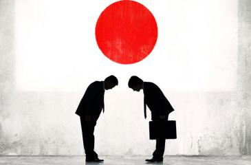 Two businessmen greet each other in Japan