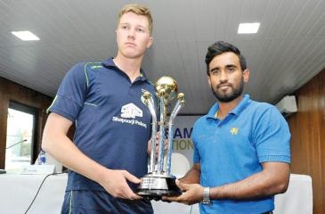Ireland A captain Harry Tector (left) and his Sri Lankan counterpart Ashan Priyanjan hold the trophy they will play for