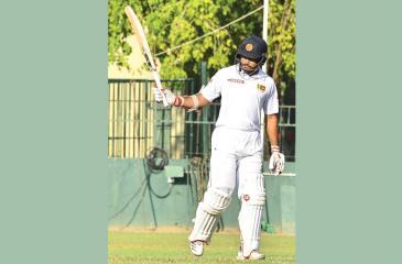 Sri Lanka A batsman Milinda Siriwardena acknowledges his half century against Ireland A at the SSC ground in Colombo yesterday