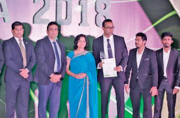 The eMarketingEye team with the award.
