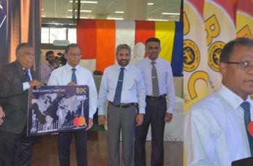Bank of Ceylon CEO and General Manager Senarath Bandara hands over the 'BOC – CH 17' co-branded 'Multi Currency Travel Card - MasterCard' to Joint Apparel Association Forum Secretary General Tuli Cooray. Deputy General Manager International, Treasury and Investment, D.P.K. Gunasekera, Assistant General Manager International S. Sivanjan and Chanel 17 (Pvt) Ltd., CEO Jumar Preena look on.