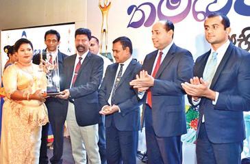 An entrepreneur receives an award.