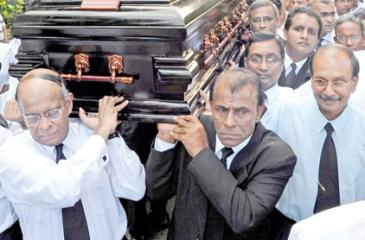 The pall bearers at Lasantha Wickrematunge's funeral AFP