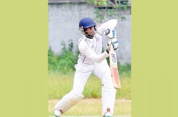 Wesley College batsman Kavindana Perera drives a ball (Picture by Saman Mendia)