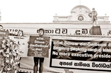 Placard bearing Aluth Piyapath activists at the Fort Railway Station