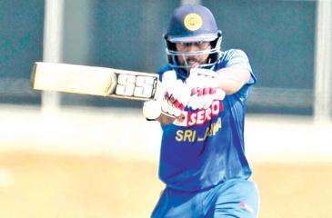 Avishka Fernando pulls a ball on his way to a century