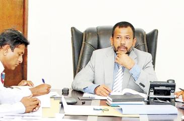 Minister of Industry and Commerce, Resettlement of  Protracted Displaced Persons and Cooperative Development Rishad  Bathiudeen at the progress review meeting with Ministry Secretary K.D.N. Ranjith  Ashoka (right) and Registrar General of Companies D.N.R. Siriwardena (extreme left).