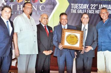 Chairman of CG Corp Global Dr Binod Chaudhary (fourth from left) with the Lifetime Achievement Award at the Hotel Investment and Networking Conference Sri Lanka. Joining the presentation party was Tourism Development, Wildlife and Christian Affairs Minister of Sri Lanka John Amaratunga (second from left) with Chaudhary's hospitality partners in Sri Lanka, Chairman of Galle Face Hotel Group Sanjeev Gardiner, Chairman of CG Hospitality Lanka Tilka de Zoysa, HOTELiVATE Founder Chairman Manav Thadani and Chairm