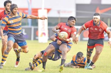 CR full back Kevin Dixon is held by an Army defender    Pic: Saman Mendis