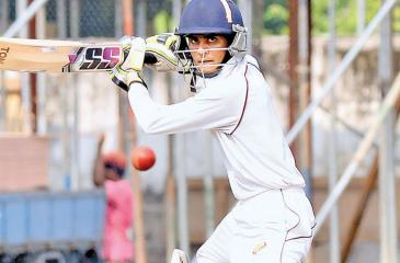 Prince of Wales College batsman Devaka Peiris cuts a ball during his half century in their match against St. Peter's College Pic: Saman Mendis