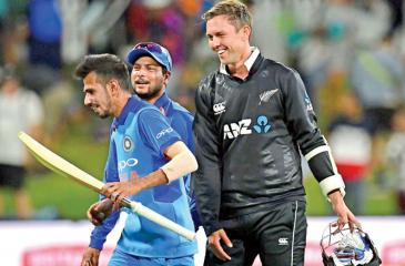 India's Yuzvendra Chahal (L) takes off with New Zealand's Trent Boult's bat after India's win during the second one-day international (ODI) cricket match in Tauranga yesterday (AFP)