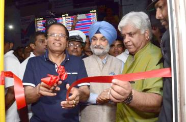 President Maithripala Sirisena cuts the ribbon to flag the train off while Minister Arjuna Ranatunge and Indian High Commissioner Taranjit Singh look on