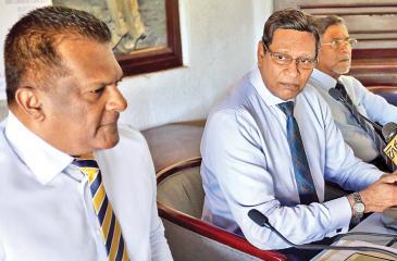 Sumathipala camp heavyweights Shammi Silva (left) and Mohan de Silva throw down the gauntlet as election fever hots up