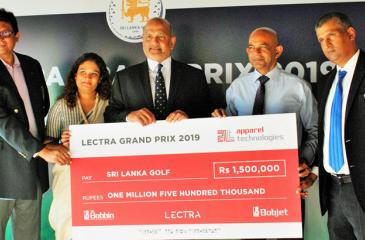 President of the Sri Lanka Golf Union Air Marshal Harsha Abeywardene (centre) receiving the sponsorship payment for the LECTRA Grand Prix Golf Championship from Raj Sunderaraj director of Apparel Technologies in the presence of Nadeesha de Silva the Business Development Manager Apparel Group