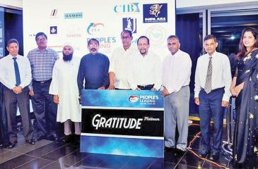 Some of the customers who received 'Gratitude' Loyalty Card with Deputy Chairman Pradeep Amirthanayagam and Directors of PLC at the 'Gratitude' Loyalty Card launch.