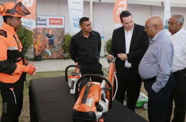 Stihl Senior Sales Manager for Middle East, India and Sri Lanka, Peter Wesner explains product features to DIMO Chairman and Managing Director Ranjith Pandithage and DIMO Group CEO Gahanath Pandithage. DIMO Assistant General Manager of Power Tools Division, Kumar Rodrigo looks on.